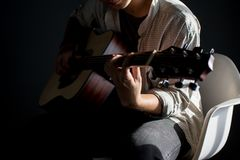 Musician playing the guitar. Thailand Royalty Free Stock Image