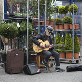 Musician playing the guitarbackground at Columbia flower market Stock Photo