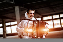The musician playing the harmonica stock image