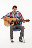 Musician playing his guitar. Royalty Free Stock Photos