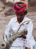 The musician. A musician is playing his music instrument in Rajasthan, India Royalty Free Stock Photo