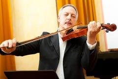 Musician playing his violin Stock Photos
