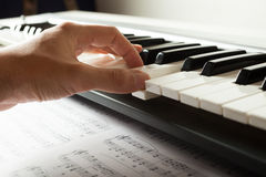 Musician playing a keyboard Royalty Free Stock Photo