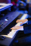 Musician playing keyboard Stock Images