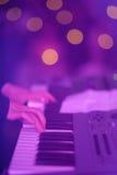 Musician playing keyboard stock photos