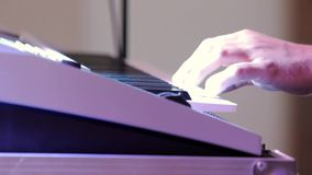 Musician playing the keyboard at the party stock video