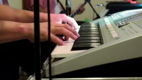Musician playing the keyboard at the party stock video footage