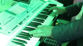 Musician playing on the keyboard synthesizer piano keys. Musician plays a musical instrument on the party. mans hsnds. Close up stock footage