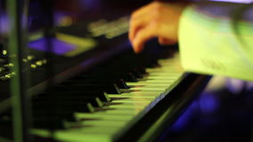Musician playing on keyboards close up stock video