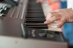 Musician playing on keyboards Royalty Free Stock Photo