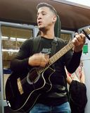 Musician playing in the Madrid metro royalty free stock photo