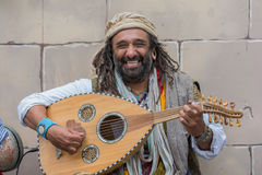 Musician playing medieval instruments Stock Photography