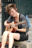 Musician playing for money on a street Royalty Free Stock Photography