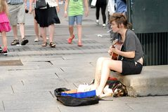 Musician playing for money on a street Stock Photo