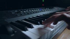 Musician plays a MIDI keyboard stock video
