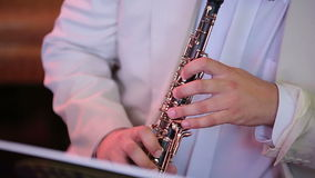 Musician playing the oboe stock video footage