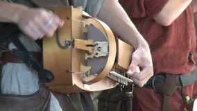 Musician playing on old instruments stock video footage