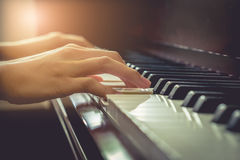 Musician playing piano in chruch with vintage filter. with motning light.. Musician playing piano in chruch with vintage filter. with motning light Stock Image