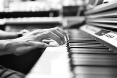 Musician playing piano. Close up of musician playing piano Stock Photography