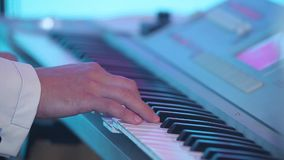 Musician is playing the piano. Close up. Dynamic change of focus. Close up stock video footage