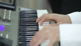 Musician is playing the piano. Close up stock footage
