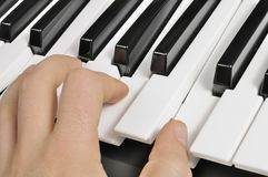 Musician Playing the Piano (MIDI Keyboard) Royalty Free Stock Photo