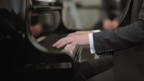 Musician playing the piano. At wedding stock video