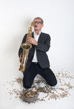 Musician playing a saxophone Stock Photos