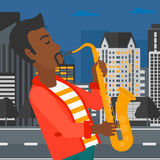 Musician playing saxophone. Stock Image
