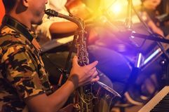 Musician playing the saxophone on band Stock Image