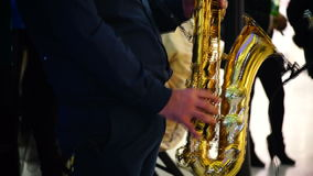 Musician is playing on saxophone in concert. Close-up on fingers pressing the keys of the instrument stock video