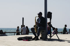 Musician playing saxophone in harbor of Tel Aviav Royalty Free Stock Photos