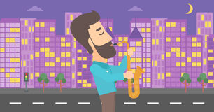 Musician playing saxophone. Stock Photo