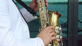Musician playing the saxophone stock video