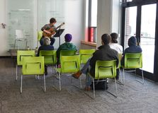 Musician playing at student art show Stock Photos