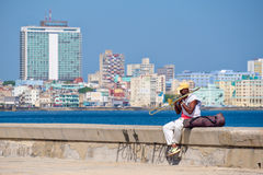 Musician playing the trombone at the famous Malecon wall in Havana Royalty Free Stock Photography