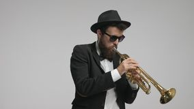 Musician playing a trumpet stock footage