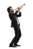 Musician playing a trumpet Stock Images