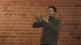 Musician playing the trumpet. Professional shot in 4K resolution. You can use it e.g. in your commercial video, business, presentation, broadcast video royalty free stock photos
