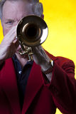 Musician Playing trumpet On Yellow Stock Images