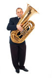 Musician playing the tuba. Young tubaist is playing his instrument Stock Image