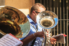 Musician playing a tuba at the celebration in the city Agrigento Royalty Free Stock Photography