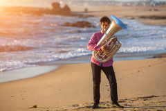Musician playing the Tuba musical instrument on the sea coast. Royalty Free Stock Photography