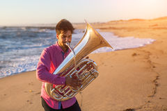Musician playing the Tuba on the sea coast. Musical instrument. Stock Photography