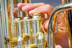 Musician playing tuba in street orchestra Stock Photos