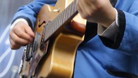 Musician playing vintage the guitar close-up. Musician playing the guitar close-up. Retro, vintage guitar. Man hands strumming strings of the musical instrument stock video