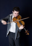 Musician playing a viola. Portrait of the musician playing a viola Royalty Free Stock Images