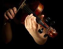 Musician playing violin. Isolated on black Stock Image