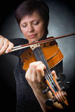 Musician playing violin Royalty Free Stock Image