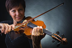 Musician playing violin Stock Photos
